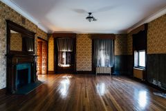 Derelict Ornate Room with Beautiful Wallpaper & Fireplace - Abandoned Harrisburg State Hospital - Harrisburg, Pennsylvania royalty free stock photography