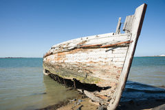 Derelict oyster boat on beach Royalty Free Stock Photo