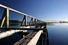 Derelict Pier. At sunrise on Lake Taupo, New Zealand royalty free stock images