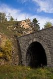 Derelict railway tunnel. Derelict tunnel on railroad around the lake Baikal Royalty Free Stock Images