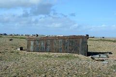 Derelict shack. A derelict shack on a pebbled beach Stock Photos