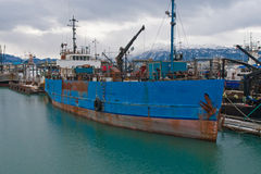 Derelict Ship. A photo of an abandoned ship in the harbor at Homer, Alaska. The ship was formerly a seafood processor Royalty Free Stock Photography
