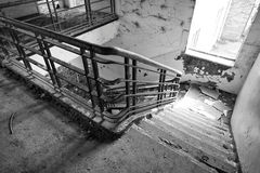 Derelict Stairs at RAF Upwood. Looking Down a Derelict set of stairs at RAF Upwood royalty free stock photos