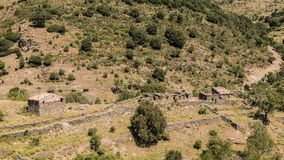 Derelict stone farm buildings in Balagne region of Corsica royalty free stock images