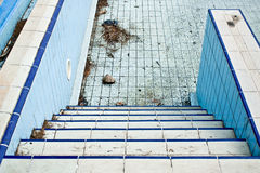 Derelict swimming pool Stock Images