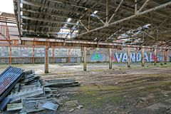 Derelict warehouse with graffiti royalty free stock photo