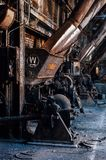 Derelict Westinghouse Underfeed Stokers - Abandoned Old Crow Distillery - Kentucky. A view of a derelict Westinghouse Underfeed Stoker in a power plant at the stock image