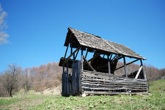 Derelict wood barn animals. An a hill, spring forest near Royalty Free Stock Photography
