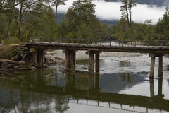 Derelict wooden bridge along the Carretera Austral. Derelict wooden bridge over the River Risopatron located along the Carretera Austral in the Aysen Region of stock photo