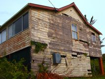 Derelict Wooden House. Derelict wood, weatherboard or clapboard, house, needing major repairs or renovation royalty free stock images