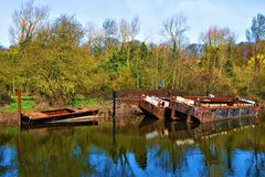 Dereliction and rural rusting and reflections, on Sprotbrough Flash, Doncaster. Taken to capture the sense of a combined decay of manmade industry and the final royalty free stock photography