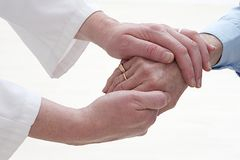 Derforming arthritis prevention on old woman hands Royalty Free Stock Image