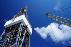 Derick of jack up drilling rig with the rig crane Royalty Free Stock Photo