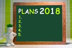 Derida su, sul fondo di legno degli indicatori e sul fondo per l'inserzione, 2018, i nuovi yers felici, piani Immagini Stock Libere da Diritti