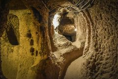 The Derinkuyu underground city is an ancient multi-level cave city in Cappadocia, Turkey. Stock Photography