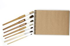 Derisione del taccuino su per materiale illustrativo con le pitture dell'acquerello isolate su fondo bianco fotografia stock