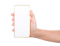 Derisione femminile dello smartphone del telefono cellulare dell'oro della tenuta della mano su Fotografia Stock Libera da Diritti