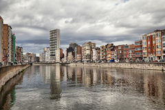 Derivation of river Meuse under cloudy sky in Liege Stock Photos