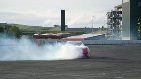 Derive a competência, carro da tração, fumando pneumáticos Fotografia de Stock