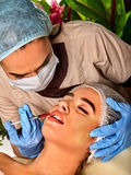 Dermal fillers lips of woman in spa salon with beautician. Stock Images
