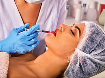 Dermal fillers lips of woman in spa salon with beautician. Stock Photography
