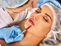 Dermal fillers lips of woman in spa salon with beautician. Royalty Free Stock Images