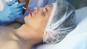 Dermal fillers of man in spa salon with beautician. stock video