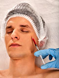 Dermal fillers of man in spa salon with beautician. Stock Photography