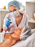 Dermal fillers of man in spa salon with beautician. Royalty Free Stock Photography