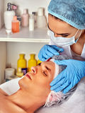 Dermal fillers of man in spa salon with beautician. Stock Images