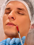 Dermal fillers of man in spa salon with beautician. Stock Photos