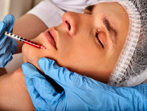 Dermal fillers of man in spa salon with beautician. Royalty Free Stock Photos