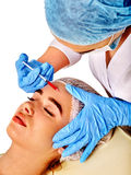 Dermal fillers of woman in spa salon with beautician. Stock Images