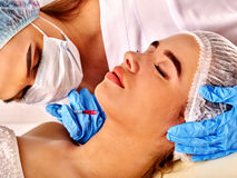 Dermal fillers of woman in spa salon with beautician. Royalty Free Stock Photos