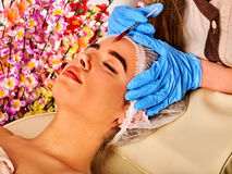 Dermal fillers of woman in spa salon with beautician. Stock Photo