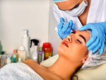 Dermal fillers of woman in spa salon with beautician. Royalty Free Stock Image