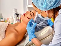 Dermal fillers of woman in spa salon with beautician. Royalty Free Stock Images