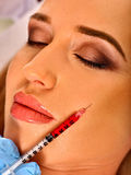 Dermal fillers of woman in spa salon with beautician. Royalty Free Stock Photo