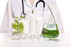 Dermatologist with natural skin care, Green herbal organic beauty product discovery at science lab Stock Photography