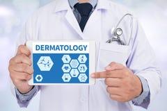 DERMATOLOGY. Doctor holding digital tablet royalty free stock photo