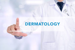 DERMATOLOGY message. Medicine doctor working with computer interface as medical concept Stock Photo