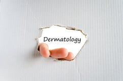 Dermatology text concept. Business man hand writing dermatology Stock Image