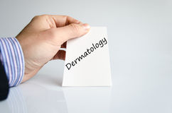 Dermatology text concept. Business man hand writing dermatology Royalty Free Stock Photo