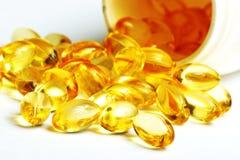 Derramamento da vitamina fotografia de stock