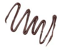 Derramamento derretido quente do chocolate isolado no fundo branco, vista superior Fotografia de Stock