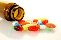 Derramamento dos comprimidos Imagens de Stock