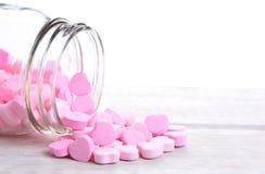 Derramamento dos corações dos doces Imagem de Stock Royalty Free