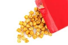 Derramamiento del maíz del caramelo Imagen de archivo libre de regalías
