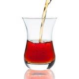 Derramando um copo do chá Foto de Stock Royalty Free