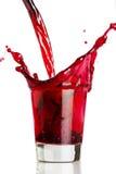 Derramando uma bebida vermelha Fotografia de Stock Royalty Free